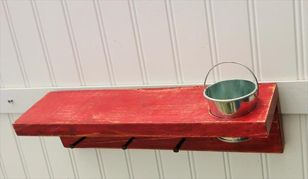 recycled pallet painted key rack with tin bucket