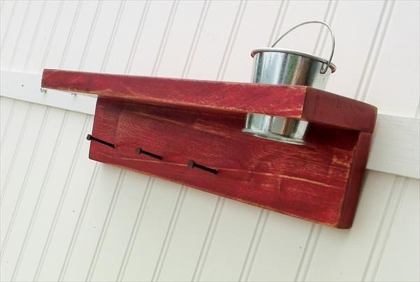 rustic yet modern red pallet key rack with tin bucket
